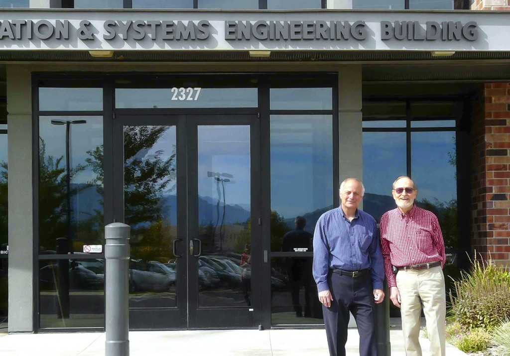 Steve Albert and John West (founder of WTI) stand in front of the WTI offices