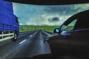 Western Transportation Institute (WTI) Driving simulator laboratory, shows commercial vehicle passing simulator